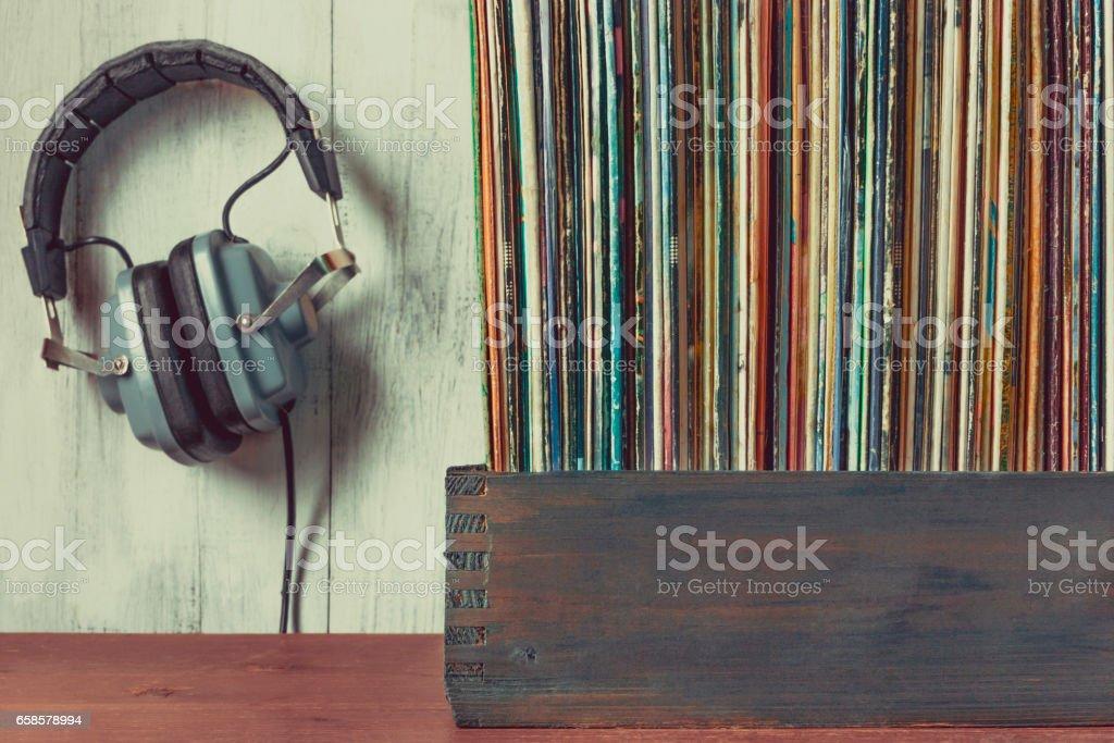 Old vinyl records and headphones stock photo