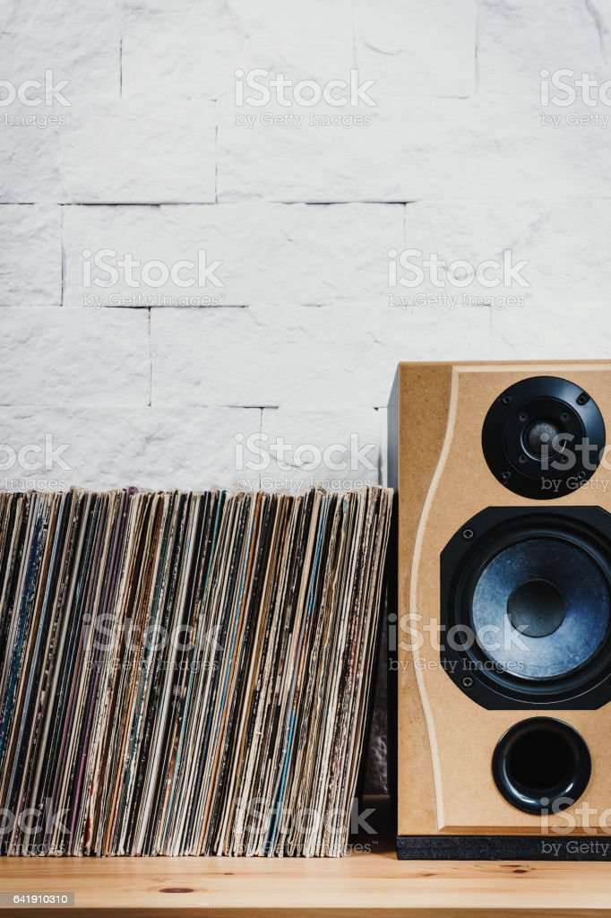 Old Vinyl records in the wooden shelf stock photo