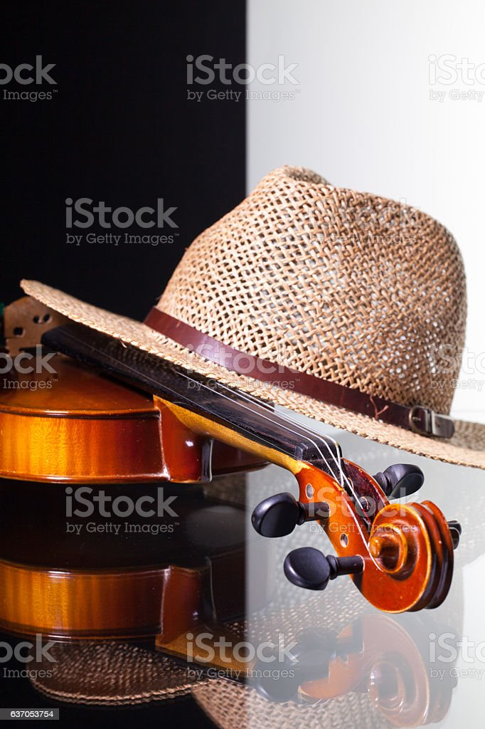 Old violin and straw hat stock photo