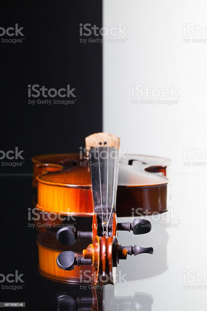 Old violin on black and white background stock photo