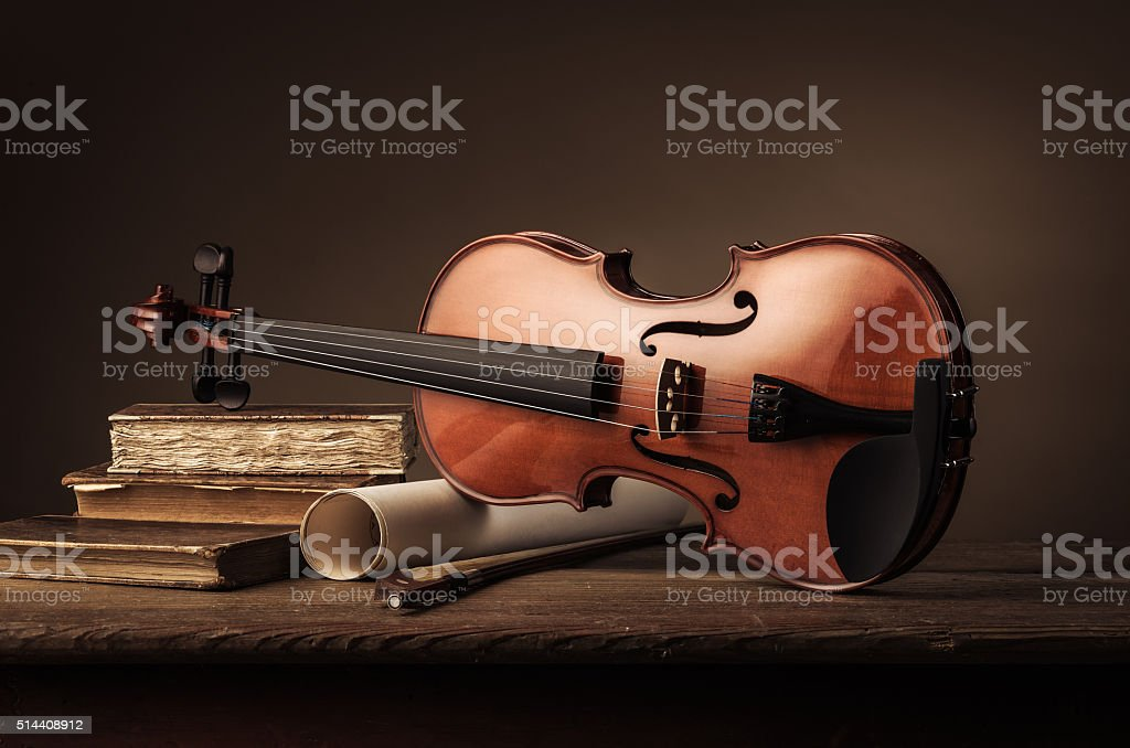 Old violin still life with books stock photo