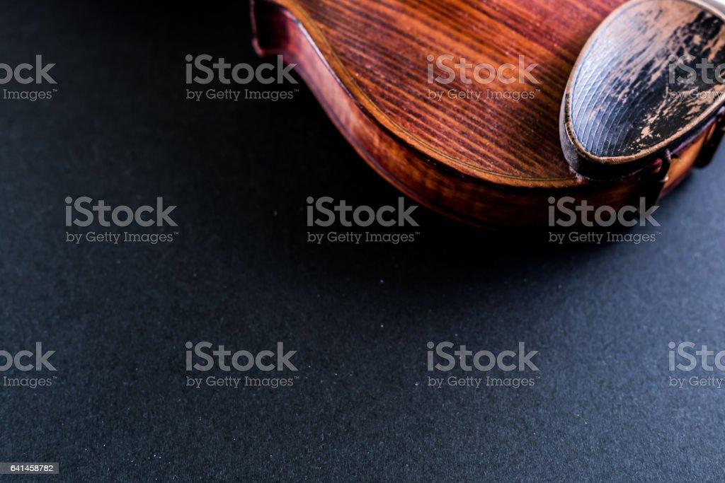 Old violine on black copy space stock photo