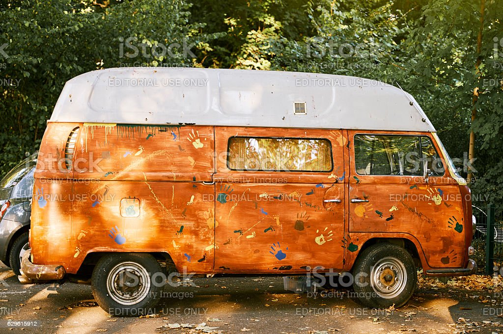 Old Vw Camper van parked painted hand-made stock photo