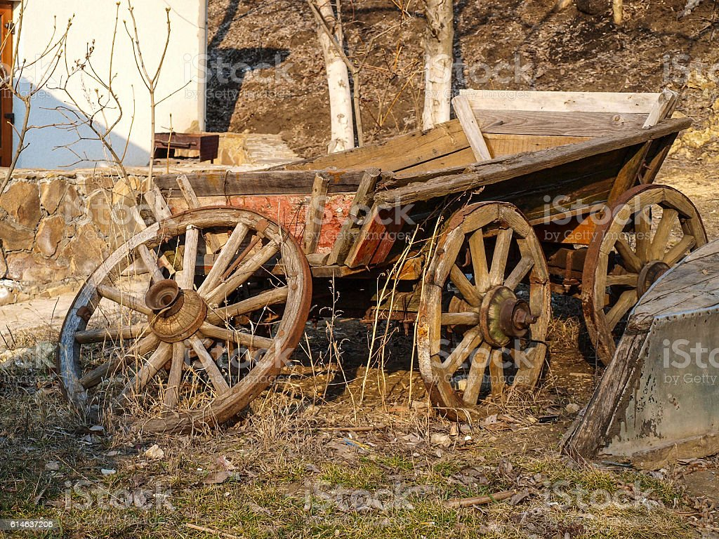 Old wagon and boat stock photo