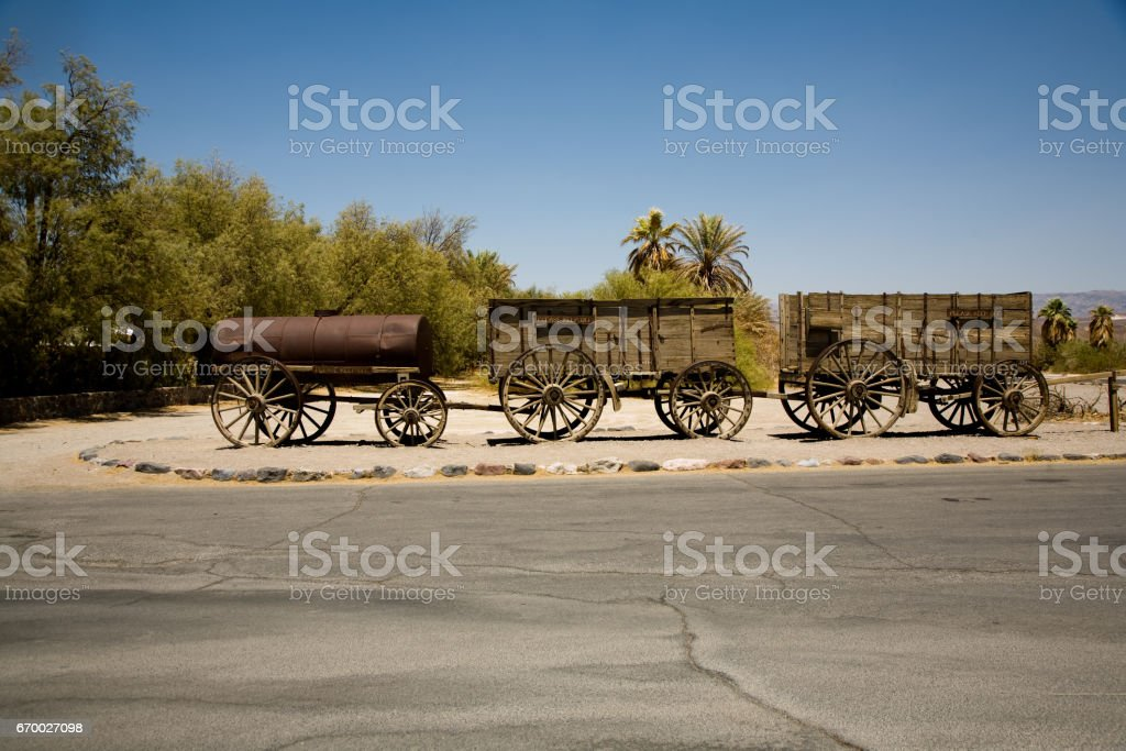 old wagon and coaches at the entrance of the Furnance Creek Ranch stock photo