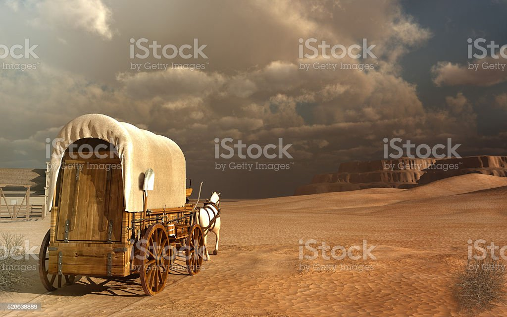 Old wagon in the desert stock photo