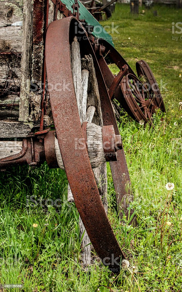 Old Wagon Wheels on Weathered Wagon stock photo