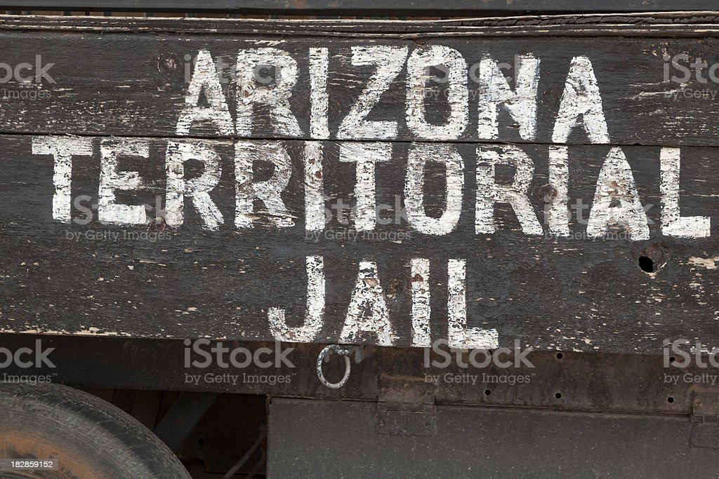 Old Wagon with ARIZONA TERRITORIAL JAIL on Side stock photo