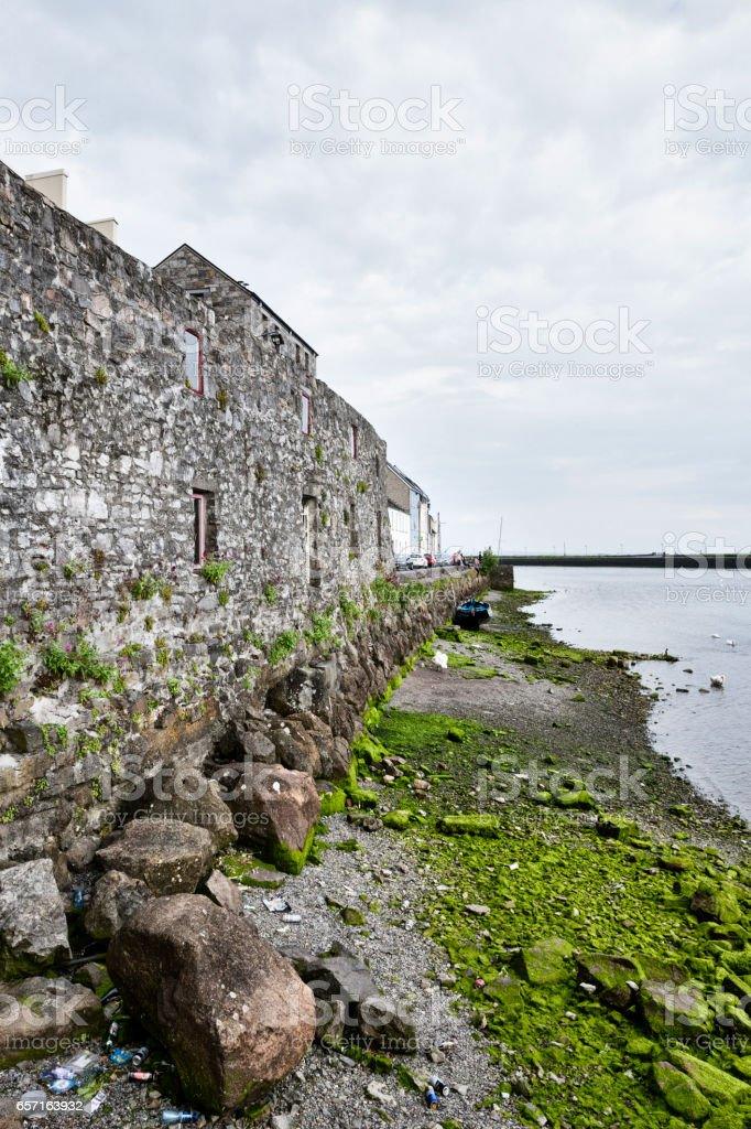 Old wall along the River Corrib in Galway, Ireland. stock photo