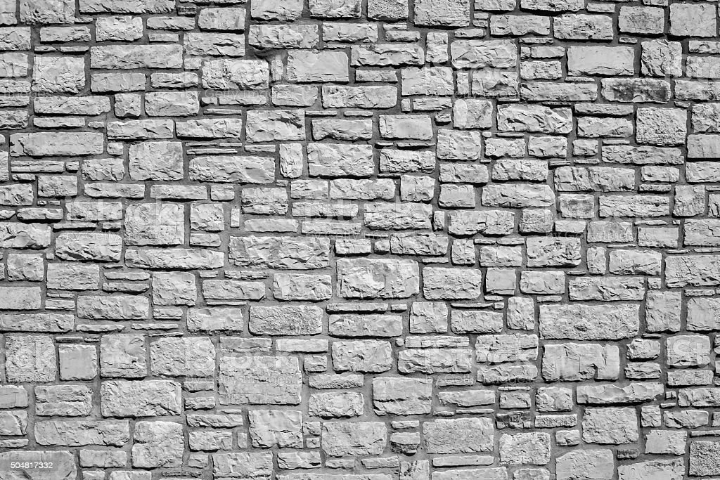 old wall from a stone brick of gray color stock photo