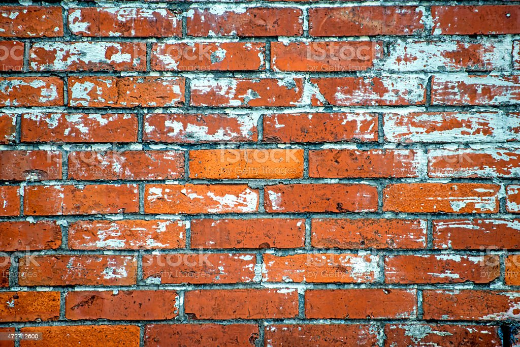 old wall of red small bricks stock photo
