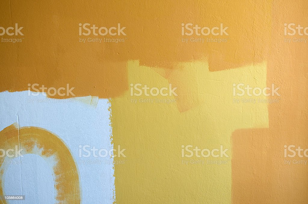 Old wall painted in yellow and orange royalty-free stock photo