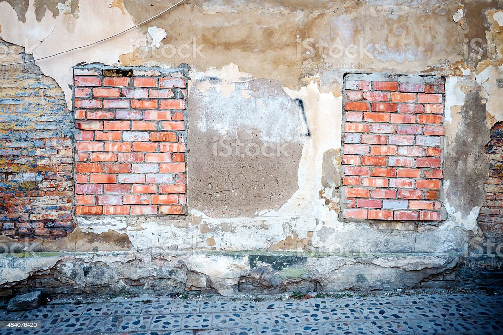Old wall with bricked up windows stock photo