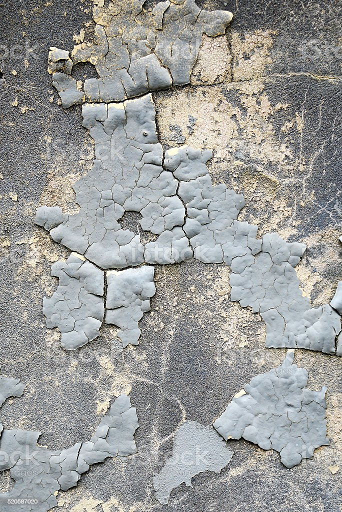 Old wall with gray, flaky paint royalty-free stock photo