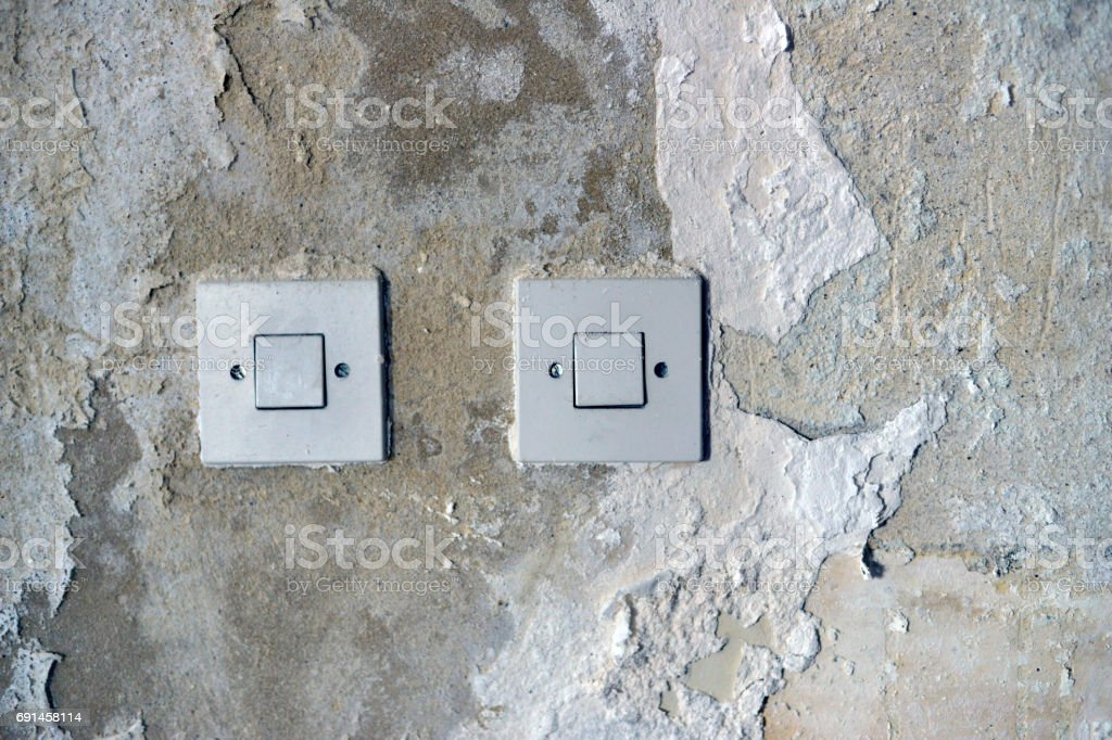 Old wall with two electric switch stock photo