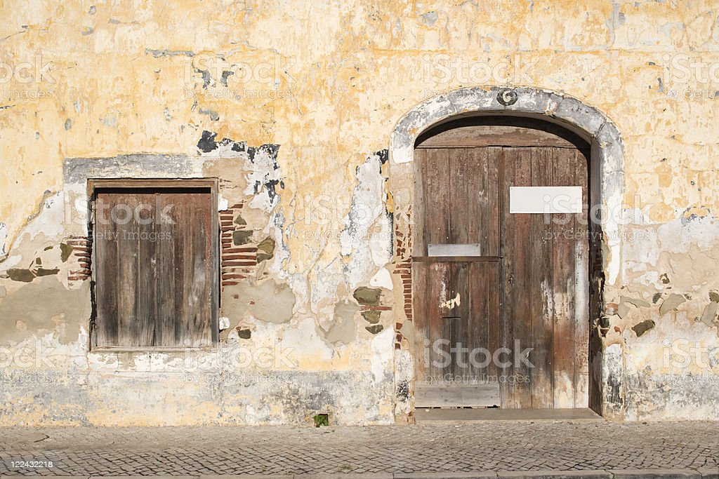 Old wall with window and door stock photo