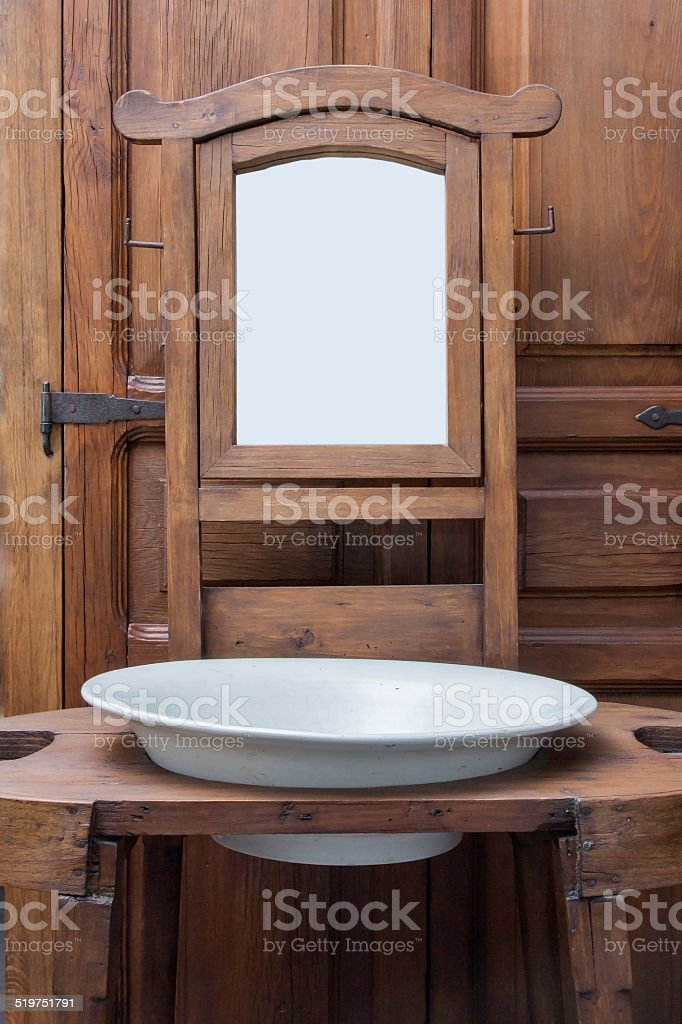 Old Washbasing and Mirror. stock photo