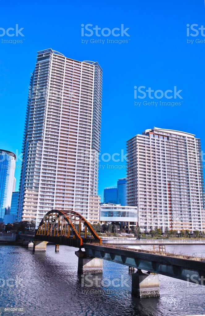 Old waste line bridge and tower apartment stock photo
