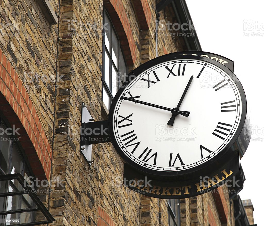 Old watch on factory building royalty-free stock photo