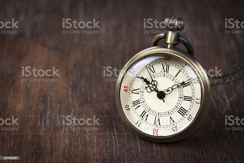 Old watch on wood table stock photo