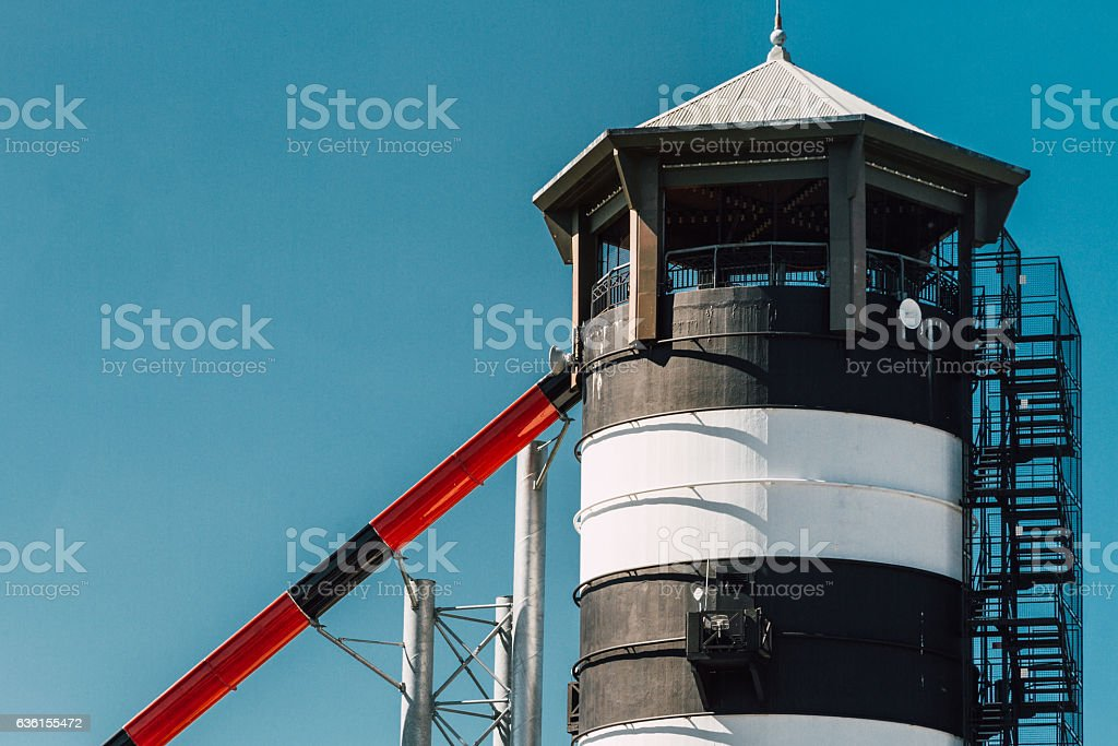 Old watchtower with pipes and ladder stock photo