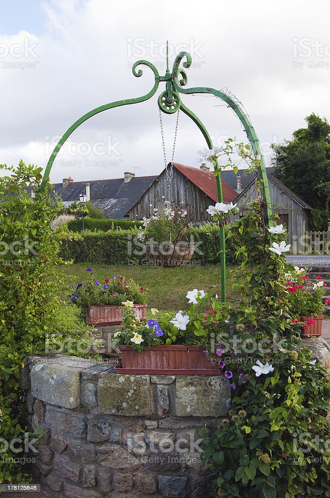 old water pit adorned with flowers stock photo
