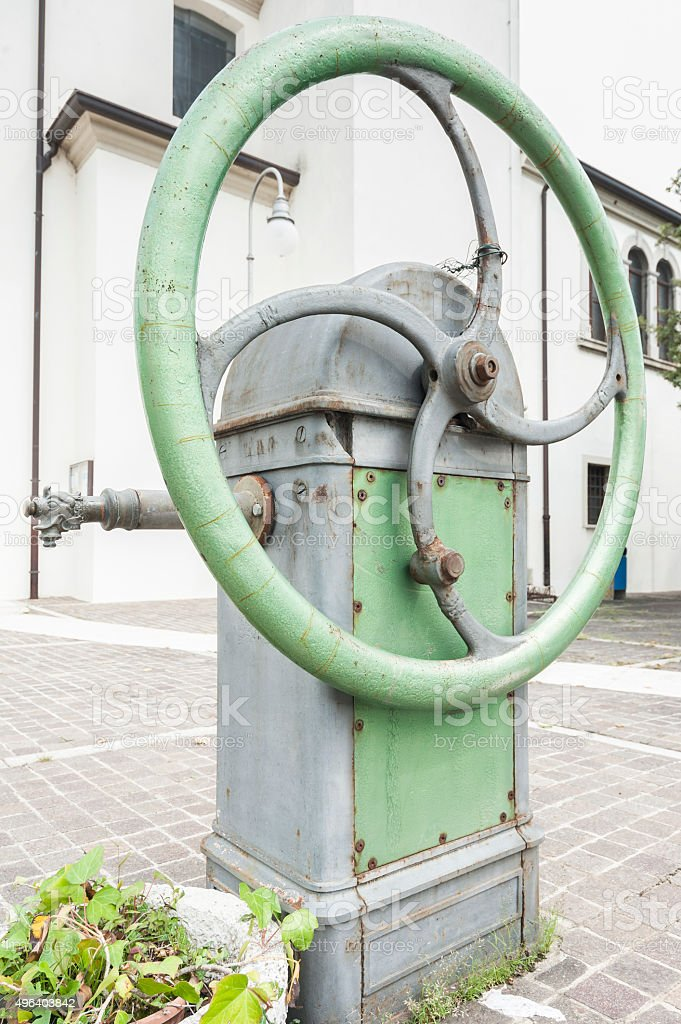 Old water pump manual stock photo