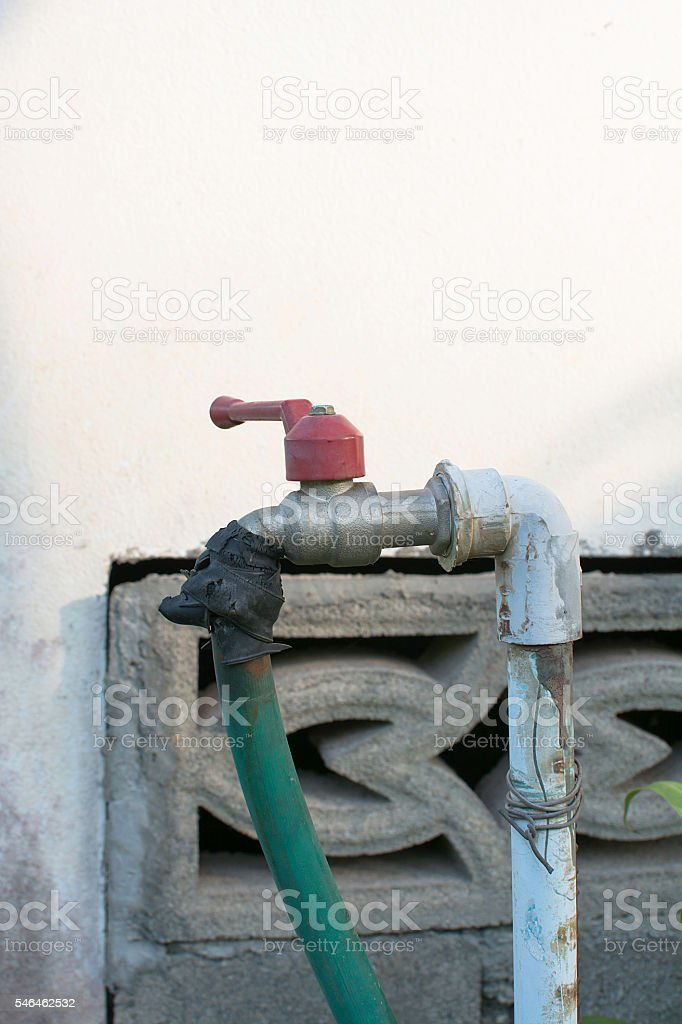 Old water tap in the garden royalty-free stock photo