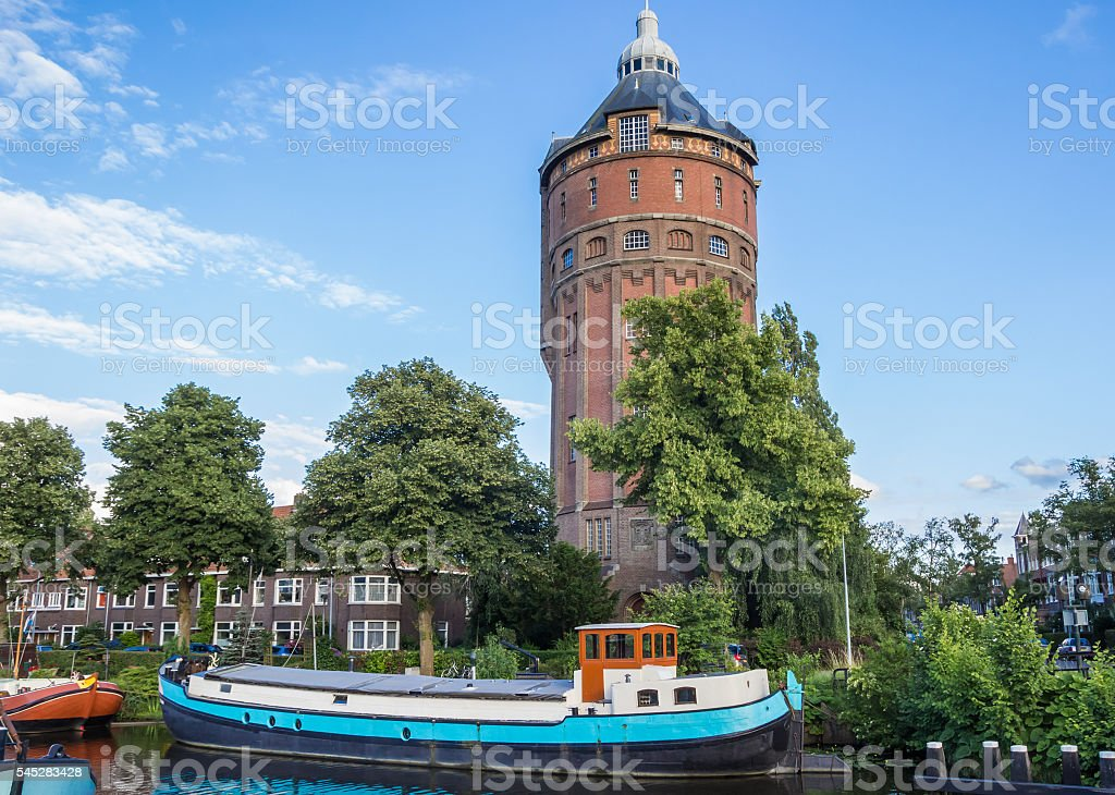 Old water tower at a canal in Groningen stock photo