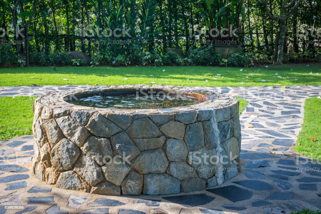 Old water well in the garden. stock photo
