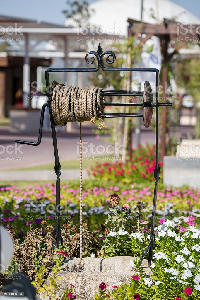 Old Water Well With Pulley and Bucket stock photo