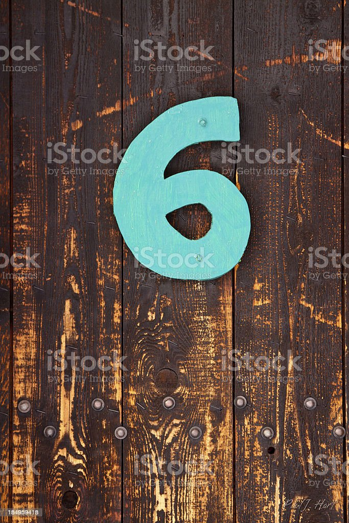 Old, weahered door with the #6 royalty-free stock photo