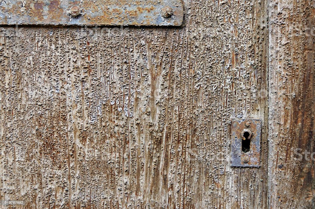 old weatered door with keyhole stock photo