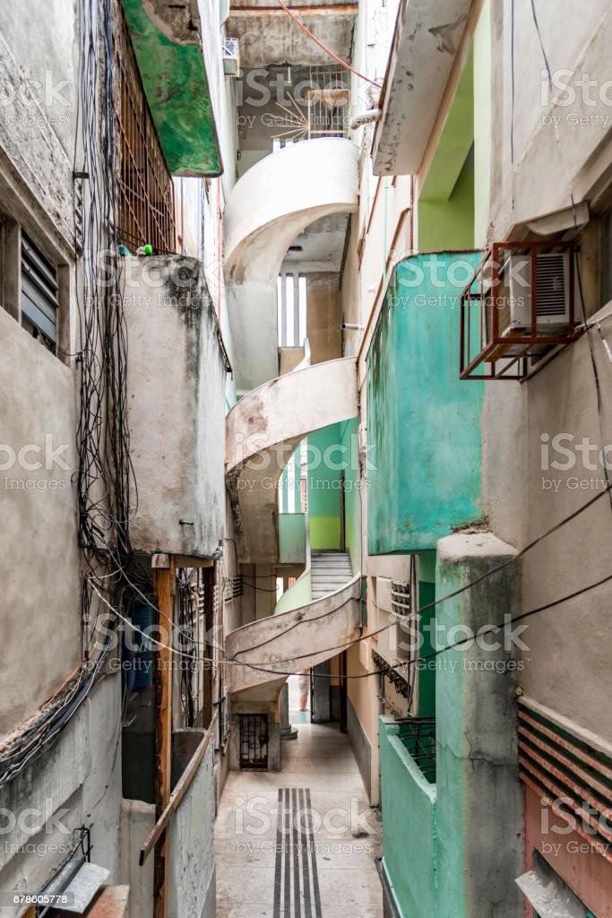 old weatherd apartment  house in art deco style in havanna stock photo