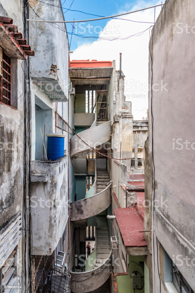 old weatherd apartment house with open stairway in havanna stock photo