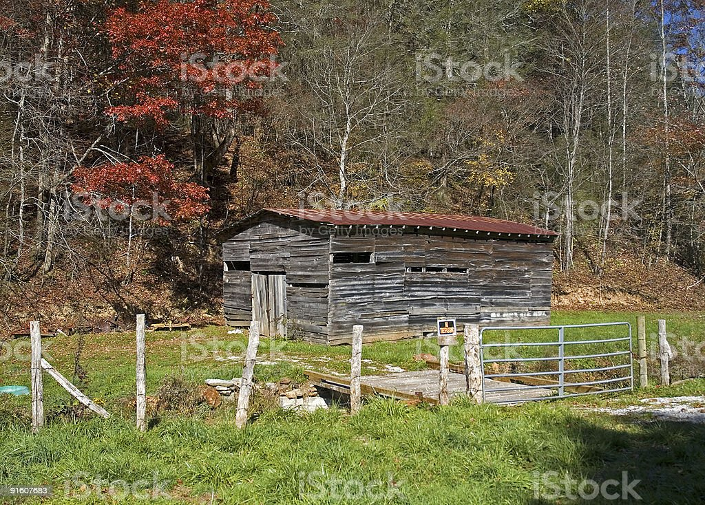 Old Weathered Barn and Fence in Auturmn royalty-free stock photo