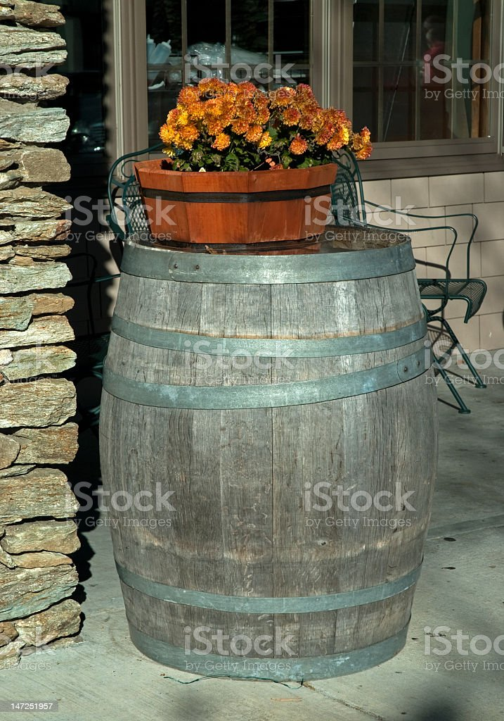 Old Weathered Barrel With a Fall Arrangement royalty-free stock photo