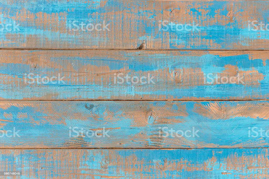 Old weathered blue wooden shelves. stock photo