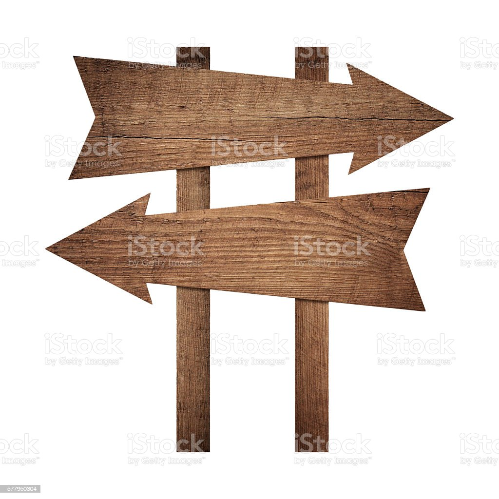 Old weathered brown blank arrows showing the direction of movement stock photo