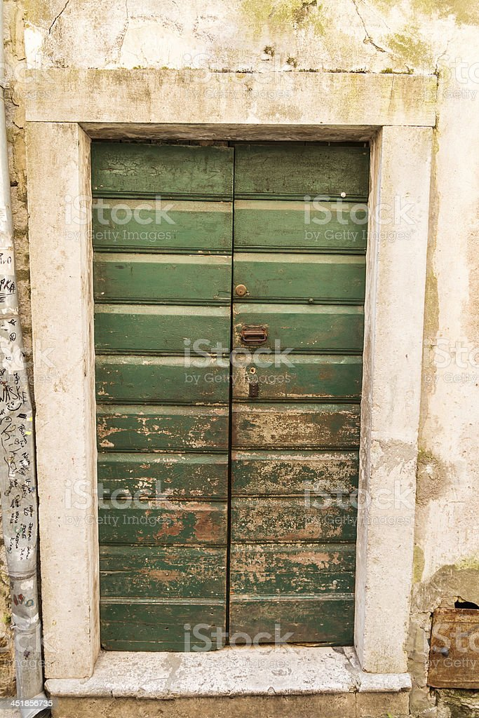 Old weathered green wooden door royalty-free stock photo