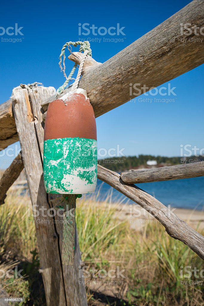 Old weathered lobster buoy stock photo