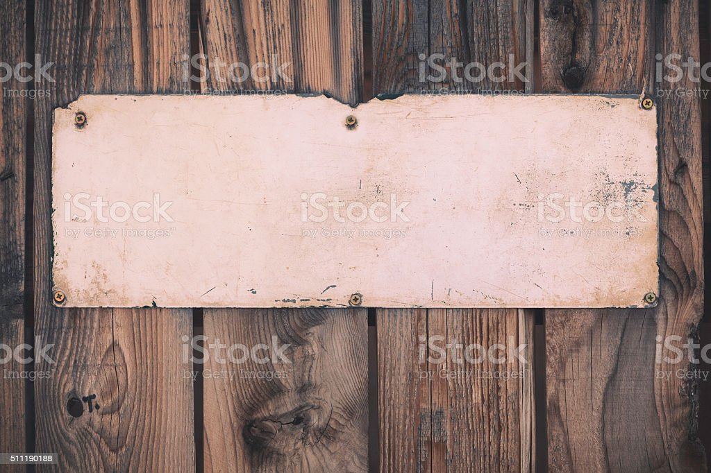 Old weathered sign on a wall stock photo