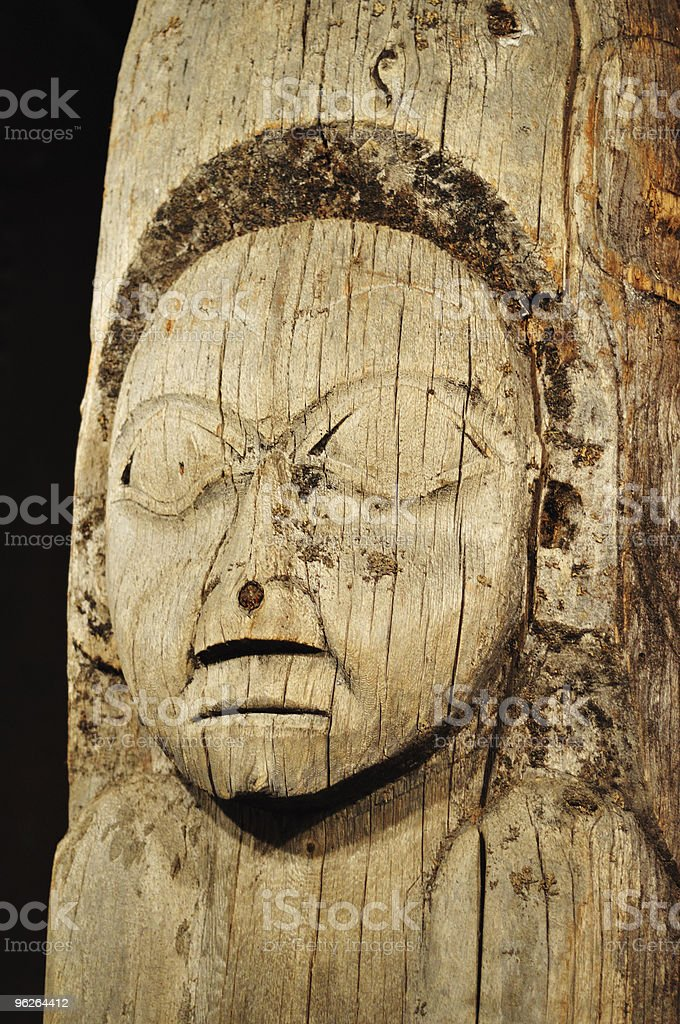 Old, Weathered Tlingit Totem Pole with Human Face stock photo