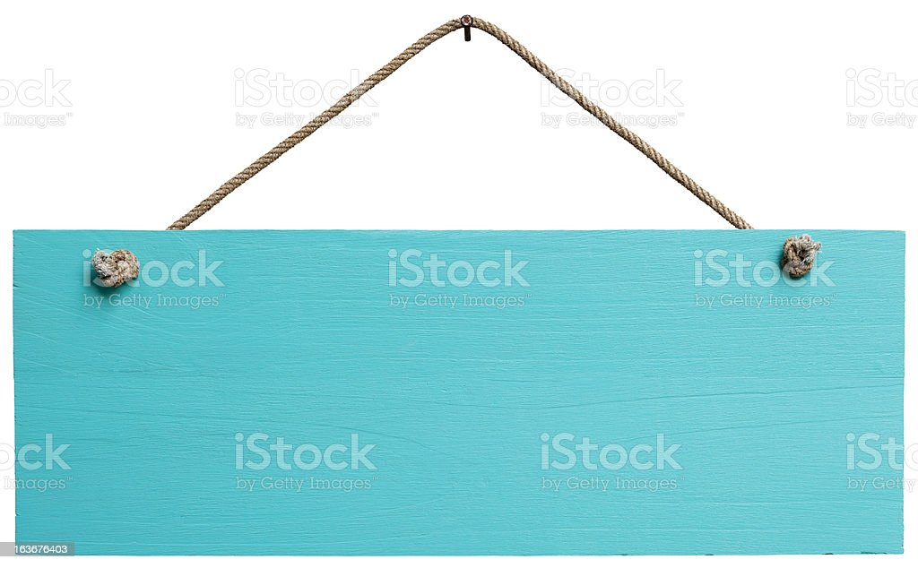 Old weathered turquoise wood signboard. royalty-free stock photo