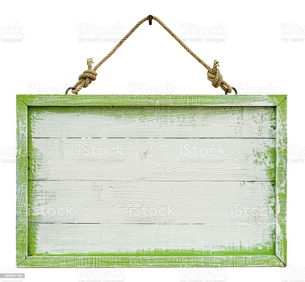 Old weathered white and green wood signboard. stock photo