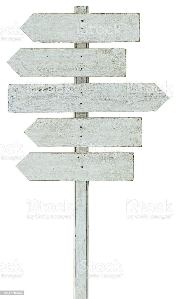 Old weathered white wood arrow shaped signboards. stock photo