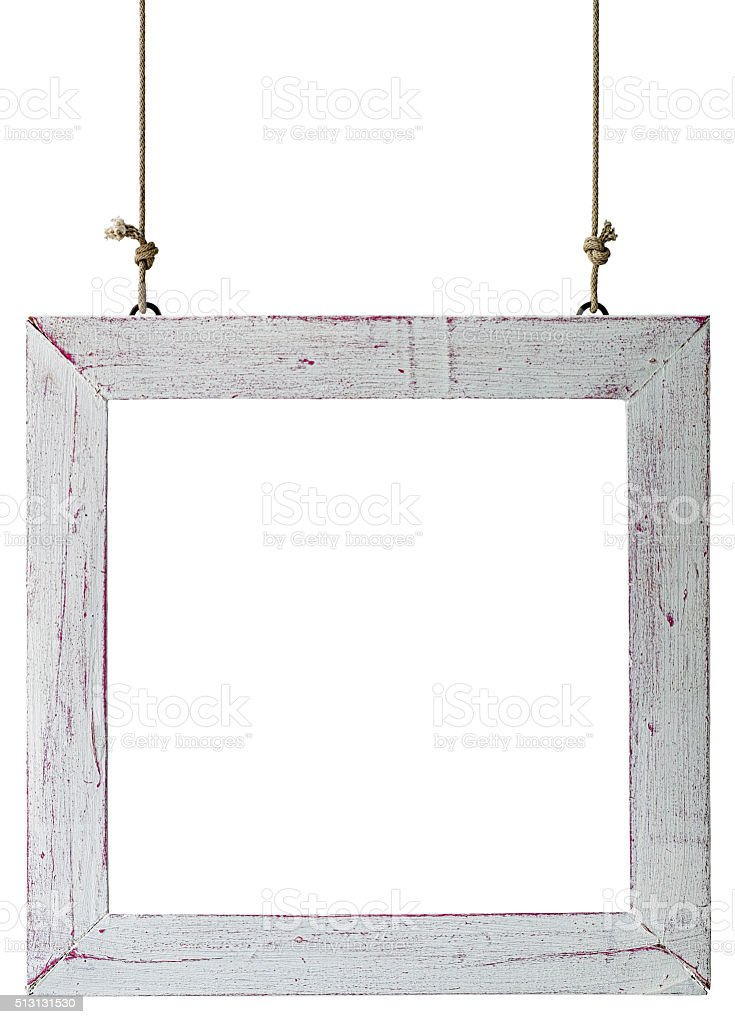 Old weathered white wood frame hanging by rope. stock photo