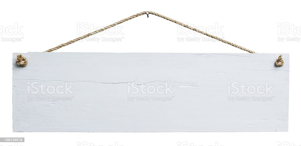 Old weathered white wood signboard. stock photo