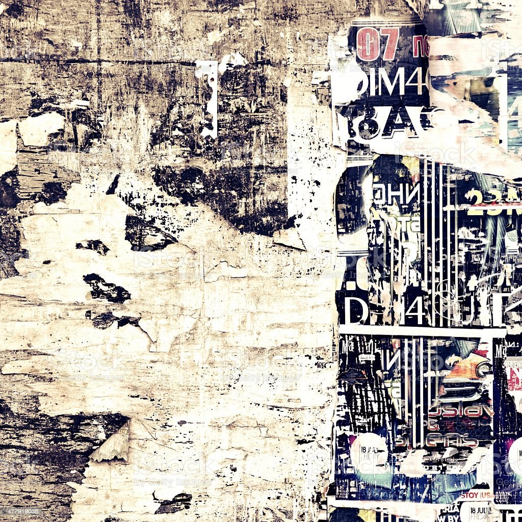 Old Weathered Wood Billboard with Torn Posters stock photo