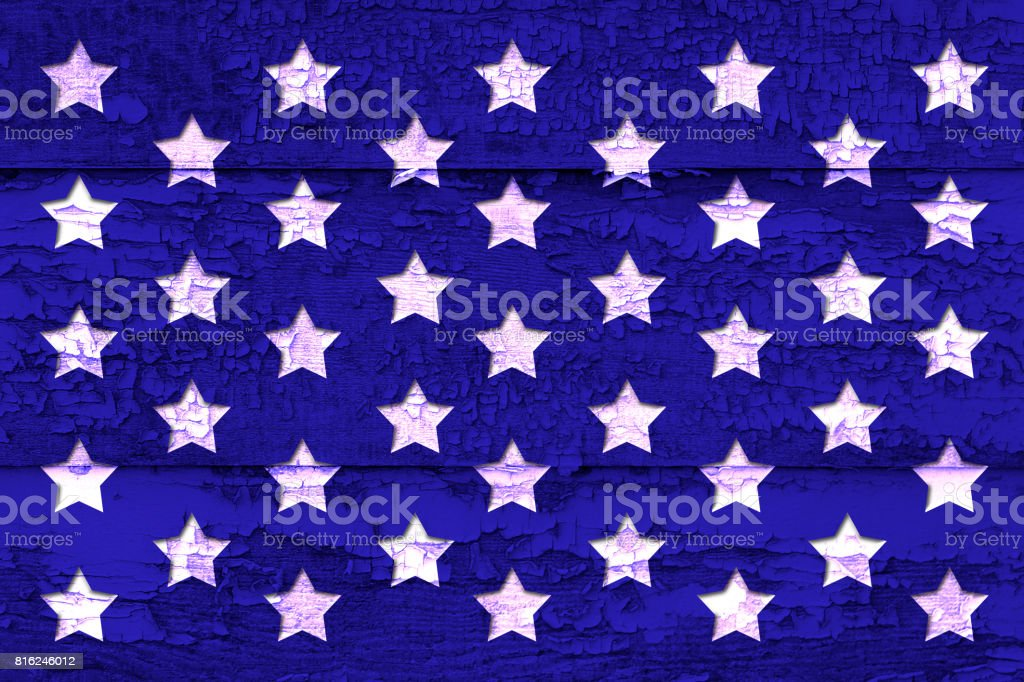 Old weathered wood board with cracked paint, dark blue with white stars, Labor Day, Independence Day, copy space, background. stock photo